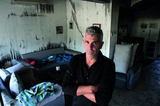 דודי בבית השרוף   צילום: אסף פרידמן